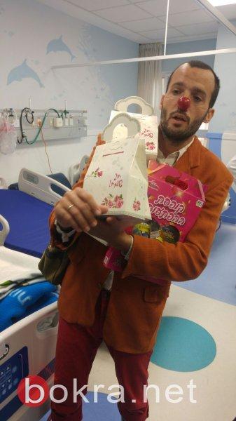 مندوبو بنك هبوعليم في كفرياسيف يعايدون ألاطفال في مستشفى نهاريا