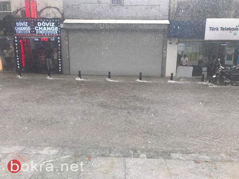 صور وفيديو، امطار غزيرة في اسطنبول بفصل الصيف