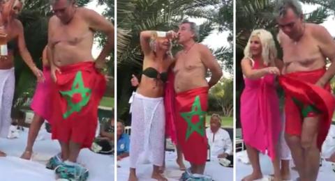 فرنسي شبه عاري بصحبة امرأتين يهينون العلم المغربي في جلسة خمرية بمراكش