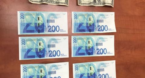 أموال مزيفة في الناصرة: اعتقال مشتبهين بحوزتهما أوراق مالية مزيفة من فئة 200