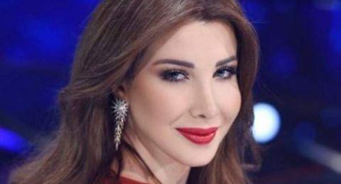 نانسي عجرم تتألق بفستان احمر انيق في مهرجان أعياد بيروت!