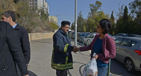 افتتاح معرض صور لمواجهة التحريض على العرب في حرائق حيفا في لجنة التربية البرلمانية