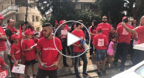 جبهة الناصرة تقوم بتوزيع منشورها الانتخابي في أحياء الناصرة