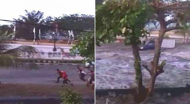 اندونيسيا: مواطنون  يركضون هربا من موجة مد جارفة