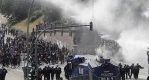 وزير ألماني يصف متظاهرين ألمان نهبوا متاجر وأحرقوا سيارات بأنهم