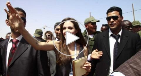 لاجئون سوريون يستقبلون انجيلينا جولي بهتافات تدعو الى اسقاط النظام السوري