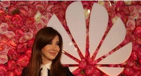 نانسي عجرم بـ«لوك» رسمي أنيق في أسبوع الموضة العربي.. صور