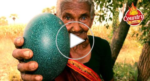 عجوز عمرها 106 أعوام ترفع 100 كيلو على ظهرها