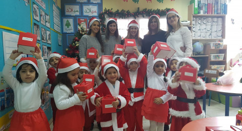 موظفو بنك هـﭙـوعليم في يافة الناصرة يقومون بأعمال تطوعية بمناسبة عيد الميلاد المجيد
