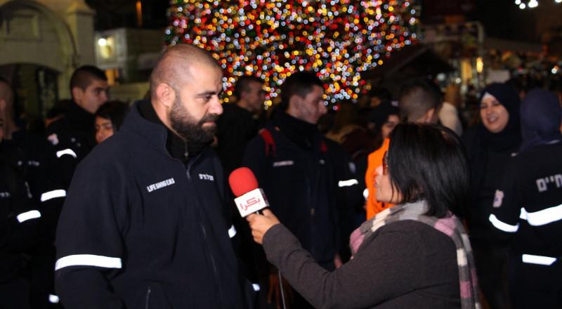 الطبيب الميداني أحمد زعبي في احتفال إضاءة الشجرة بالناصرة: سلامة المحتفلين كل همّنا