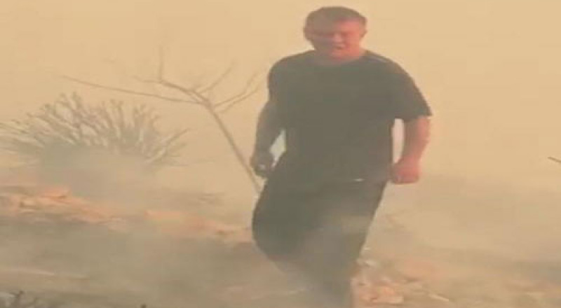 ملك الأردن عبدالله الثاني يحاول إطفاء حريق قرب القصور الملكية