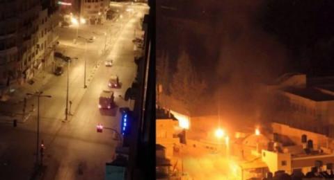 نابلس: إصابة شابين وإحراق مركبة للمستوطنين