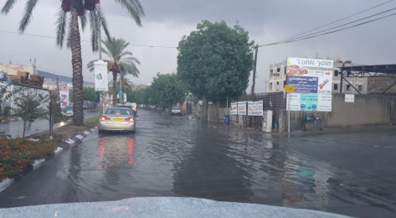 منخفض جوي وموجة أمطار تزور البلاد