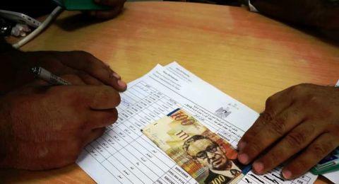 الزكاة توزع مساعدات نقدية علي 400 أسرة فقيرة في غزة
