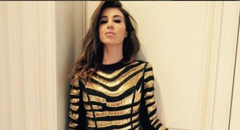 أنابيلا هلال تتألق بالأسود والذهبي في باريس