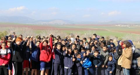 مئات الطلاب من السلطة الفلسطينية ومن الجلبوع يشاركون في مسيرة دراجات هوائية للتعايش