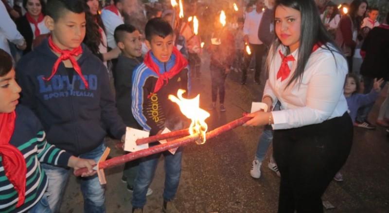 مسيرة مشاعل وامسية خطابية فنية على شرف يوم الأرض في قرية دير حنا