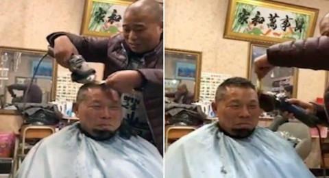 حلاق صيني يخاطر بحياة زبائنه