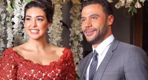ياسمين صبري ومحمد إمام بملابس المنزل على أفيش فيلم