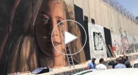القوات الإسرائيلية تعتقل إيطاليين رسما جدارية عهد التميمي