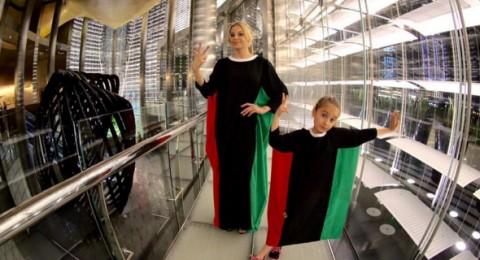 دومينيك حوراني تلبس علم الامارات على شكل فستان