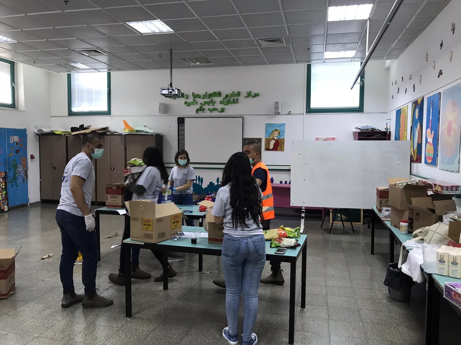 متطوعو جمعية عتيدنا يكافحون فيروس الكورونا -3