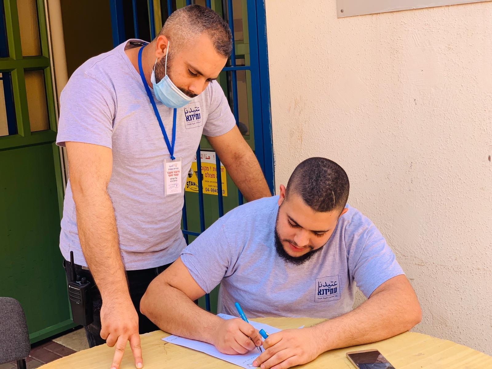متطوعو جمعية عتيدنا يكافحون فيروس الكورونا -4