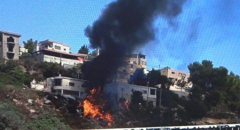 اندلاع حريق بأكوام نفايات قرب منازل في بلدة عسفيا