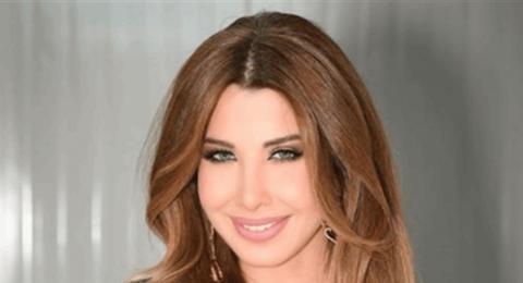 نانسي عجرم جميلة بالأبيض.. شاهدي إطلالتها في تونس