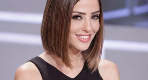 وفاء الكيلاني في لقطة رومانسية مع زوجها تيم حسن