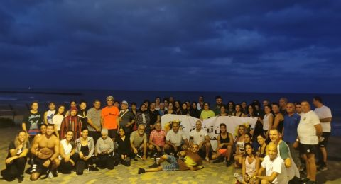 حيفا: المئات يركضون على الشاطئ في يوم الصحة النفسية العالمي