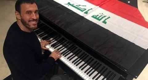 كاظم الساهر يقبل علم العراق