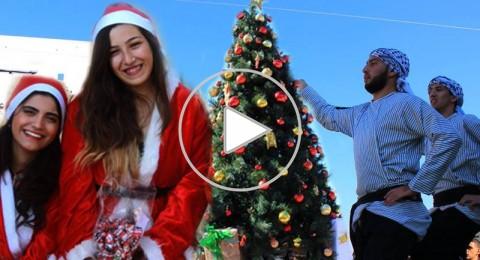 اجواء مميزه خلال انارة شجرة الميلاد في جامعة جنين
