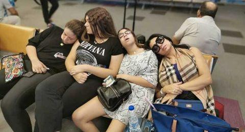 نوم رانيا يوسف وابنتيها في المطار بعد تأخر طائرتهم!
