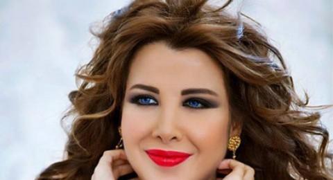 نانسي عجرم بثوب مفتوح ظهره بصورة مع زوجها