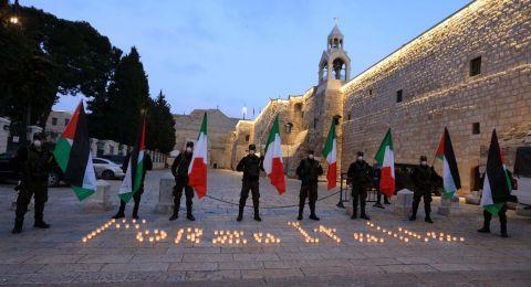 وقفة للأمن الوطني الفلسطيني في ساحة المهد تضامنا مع الشعب الإيطالي في مواجهة وباء كورونا