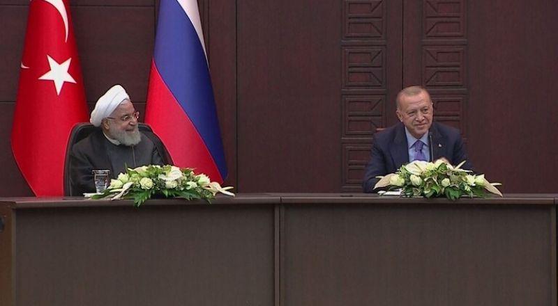 الابتسامات ترتسم على وجوه الحاضرين في مؤتمر أنقرة عقب استشهاد بوتين بالقرآن الكريم