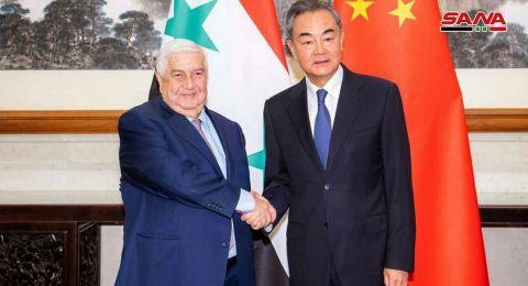 المعلم من بكين: تركيا تحتل أجزاء من الأراضي السورية وتحمي