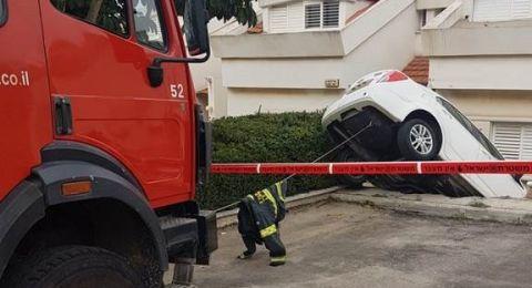 حادث طرق ذاتي يسفر عن تدهور سيارة وانقلابها في حيفا
