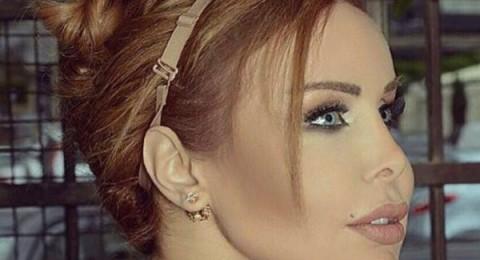 رولا سعد تضع بند حمالة الصدر على شعرها