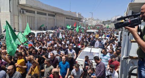 الآلاف في تشييع جثمان الشهيد والآلاف يصيحون