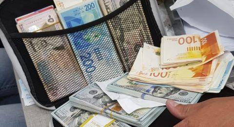 ضبط أموال وفواتير .. اعتقال مشتبه بتبييض الأموال، من بئر المكسور