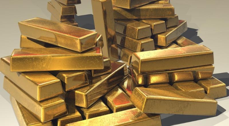 إرتفاع الدولار يدفع بالذهب للتراجع