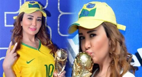 جيهان عبد العظيم و سر (كاسكيت) علم البرازيل!!