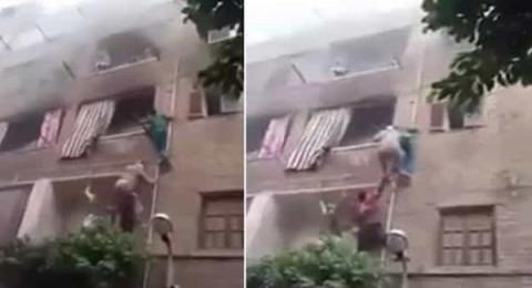 شاب مصري شجاع يتسلق المواسير وينقذ 3 أطفال من حريق