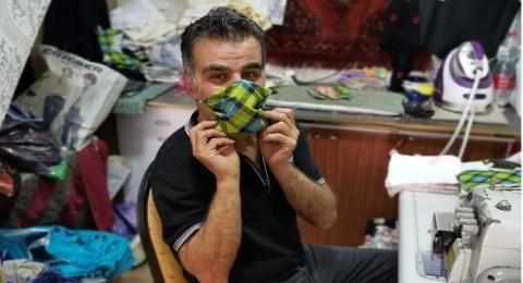 القدس: الخياط القواسمي يبدع في صنع كمامات بأساليب عصرية