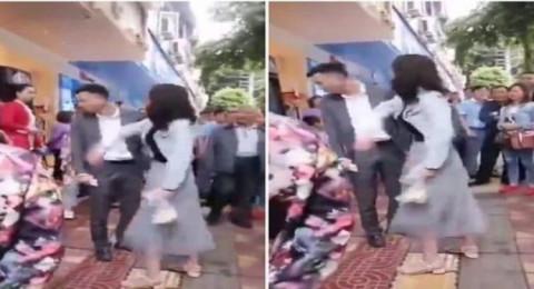 فتاة صينية تصفع شابا 52 مرة على وجهه في مكان عام