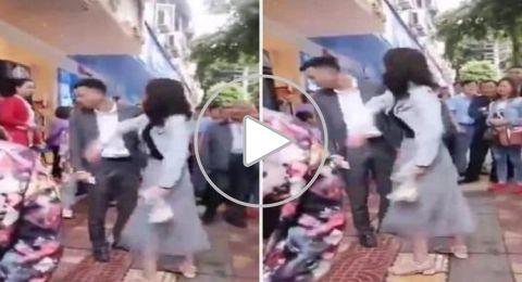 فتاة صينية تصفع شابا 52 مرة على وجهه في مكان عام ..