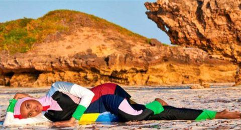 عارضة أزياء مسلمة تدخل التاريخ... جلسة تصوير بالحجاب والبروكيني