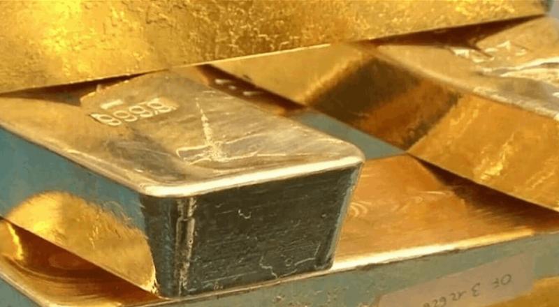 الذهب ينخفض قليلا مع ارتفاع الأسهم